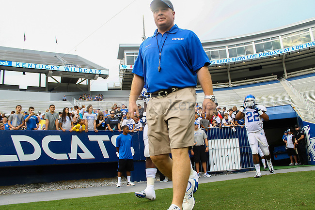 UK head coach Mark Stoops takes the field for practice on Fan Day on Friday, August, 9th, 2013 at Commonwealth Stadium in Lexington, KY. Photo by Michael Reaves | Staff