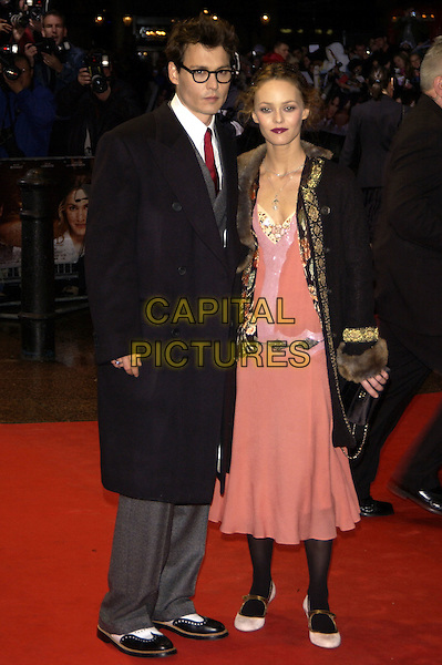 """JOHNNY DEPP & VANESSA PARADIS.""""Finding Neverland"""" UK charity premiere.Odeon, Leicester Square.London 17 October 2004..full length black coat grey suit red tie black glassespink peach vintage style dress black tights boho.Ref: PL.www.capitalpictures.com.sales@capitalpictures.com.©Capital Pictures."""