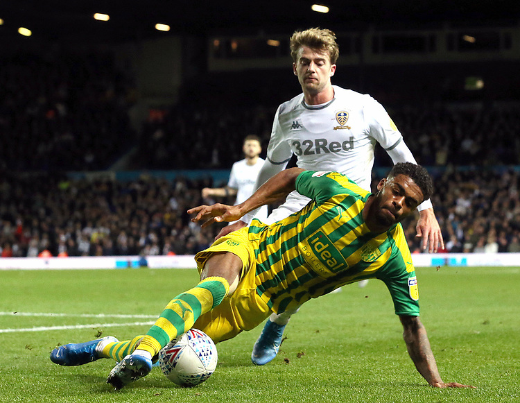 West Bromwich Albion's Darnell Furlong under pressure from Leeds United's Patrick Bamford<br /> <br /> Photographer Rich Linley/CameraSport<br /> <br /> The EFL Sky Bet Championship - Tuesday 1st October 2019  - Leeds United v West Bromwich Albion - Elland Road - Leeds<br /> <br /> World Copyright © 2019 CameraSport. All rights reserved. 43 Linden Ave. Countesthorpe. Leicester. England. LE8 5PG - Tel: +44 (0) 116 277 4147 - admin@camerasport.com - www.camerasport.com