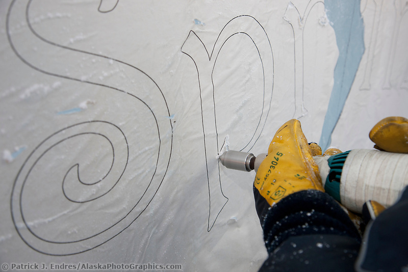 "Martin King scribes out the title of the single block sculpture ""Spring"" during the 2009 World Ice Art Championships, Fairbanks, Alaska."