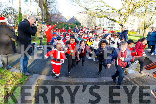 The students and staff of Moyderwell NS enjoying their annual Jingle Bells Christmas run   in the Tralee town park on Tuesday