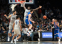 WASHINGTON, DC - DECEMBER 28: Qudus Wahab #34 of Georgetown blocks an attempt by Ben Lubarsky #30 of American. during a game between American University and Georgetown University at Capital One Arena on December 28, 2019 in Washington, DC.
