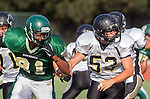 Manhattan Beach, CA 10/24/13 - unidentified Mira Costa player(s) and \pj53\ in action during the Palos Verdes Peninsula and Mira Costa Junior Varsity Football game at Mira Costa High School.