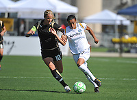 Marta and FC Gold's Leslie Osborne battle for the ball. LA Sol 2-0, over FC Gold, Sunday, May 24, 2009, at Buck Shaw Stadium, in Santa Clara, California.