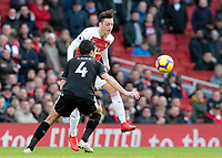Arsenal's Mesut Ozil plays the ball away from Burnley's Jack Cork<br /> <br /> Photographer David Shipman/CameraSport<br /> <br /> The Premier League - Arsenal v Burnley - Saturday 22nd December 2018 - The Emirates - London<br /> <br /> World Copyright © 2018 CameraSport. All rights reserved. 43 Linden Ave. Countesthorpe. Leicester. England. LE8 5PG - Tel: +44 (0) 116 277 4147 - admin@camerasport.com - www.camerasport.com