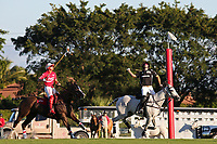 WELLINGTON, FL - DECEMBER 31:  Most Valuable Player Matt Coppola (black helmet), takes the ball out of the air to score, as Sugar Erskine (white helmet) looks on, in the Tackeria's 12-11 win in the Herbie Pennell Cup Final, at the International Polo Club Palm Beach, on December 31, 2017 in Wellington, Florida. (Photo by Liz Lamont/Eclipse Sportswire/Getty Images)