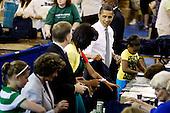 "Washington, DC - June 25, 2009 -- United States President Barack Obama (2nd R), first lady Michelle Obama (3rd R) and their daughters Malia (obscured) and Sasha (R) help volunteers and members of Congress stuff backpacks with books, food and photographs of the first dog Bo during a United We Serve event at Fort McNair June 25, 2009 in Washington, DC. Helping to fill 10,000 backpacks for children of military servicemen and women, the first family stuffed copies of ""The Lightning Thief,"" by Rick Riordan, and ""The Penderwicks,"" by Jeanne Birdsall into backpacks along with food items and a personal letter from the president and the first lady. .Credit: Chip Somodevilla - Pool via CNP"