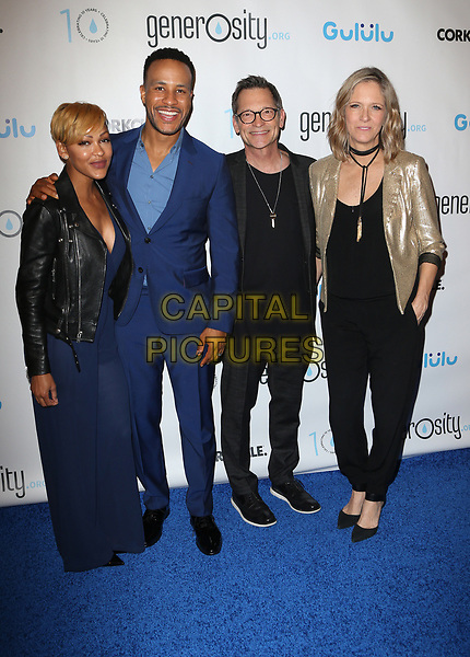 BEVERLY HILLS, CA - March 21: Meagan Good, DeVon Franklin, Philip Wagner, Holly Wagner, At Generosity.org Fundraiser For World Water Day At Montage Hotel In California on March 21, 2017. <br /> CAP/MPI/FS<br /> &copy;FS/MPI/Capital Pictures