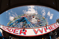The Wonder Wheel in Deno's Wonder Wheel Park on opening day in Coney Island in New York on Saturday, March 26, 2016. The opening day of Coney Island heralds the arrival of the summer season and brings out crowds hoping to escape the clutches of winter. The year the iconic wheel is 96 years old. (© Richard B. Levine)