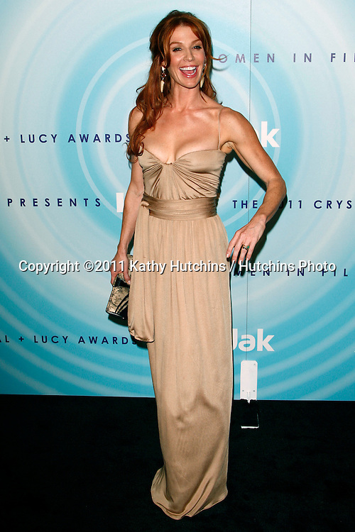 LOS ANGELES - JUN 16:  Poppy Montgomery arriving at the 2011 Women In Film Crystal + Lucy Awards  at Beverly Hilton Hotel  on June 16, 2011 in Beverly Hills, CA