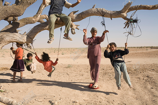 Children play outside their home near Palmyra, Syria.