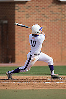 Carson Jackson (10) of the High Point Panthers follows through on his swing against the NJIT Highlanders during game one of a double-header at Williard Stadium on February 18, 2017 in High Point, North Carolina.  The Panthers defeated the Highlanders 11-0.  (Brian Westerholt/Four Seam Images)