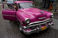 pink oldtimer, american car in Havana, Cuba