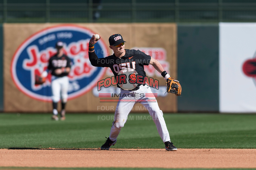 Oregon State Beavers second baseman Andy Armstrong (9) makes a throw to first base during a game against the Gonzaga Bulldogs on February 16, 2019 at Surprise Stadium in Surprise, Arizona. Oregon State defeated Gonzaga 9-3. (Zachary Lucy/Four Seam Images)