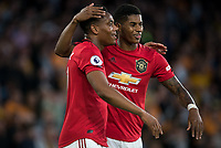 Marcus Rashford congratulates Anthony Martial of Man Utd on his goal during the Premier League match between Wolverhampton Wanderers and Manchester United at Molineux, Wolverhampton, England on 19 August 2019. Photo by Andy Rowland.