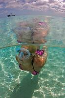 Snorkeler swimming over sandy bottom (split view), Bonaire, Netherland Antilles, Caribbean Sea, Atlantic Ocean, MR