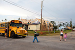 Amanda Porter and her daughter Krista Holbrooks (right), 5, walk to their temporary home after Krista gets home from school in Vaughn, Georgia August 12, 2011. In April, Vaughn was hit by a tornado that destroyed many homes in the area. Months later, the community is still picking up the pieces.