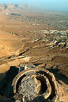 The view north from the upper terrace at Masada reveals the vast Judean Desert once ruled by Herod the Great. Built on three rock terraces supported by retaining walls and stone columns, The Northern Palace was Herod, the King of Judea's magnificent and elegant residential palace. The several rooms of the upper terrace were the King's living quarters, while the lower terraces were reserved for entertaining.