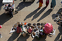 India - Manipur - Imphal - Dry fish illegal sellers sitting on the street right outside the Ima Market. Most of the youngest sellers belong to the thousands of informal, seasonal vendors squatting on the surrounding streets. They come from the hills around Imphal as early as 3am, with a few home-grown vegetables, and return home as soon as they sell them. They constitute the vast majority of the vendors, yet their presence is a constant source of tension with the Imas, who contrary to them pay taxes and complain of unfair competition.