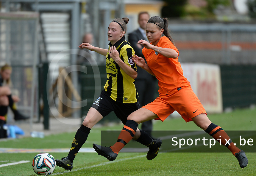 20150514 - BEVEREN , BELGIUM : duel pictured between Lierse's Elke Van Gorp (left) and Brugge's Jassina Blom (right) during the final of Belgian cup, a soccer women game between SK Lierse Dames and Club Brugge Vrouwen , in stadion Freethiel Beveren , Thursday 14 th May 2015 . PHOTO DAVID CATRY