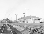D&amp;RGW #490 heading a double-headed westbound freight passing the Antonito depot.<br /> D&amp;RGW  Antonito, CO  Taken by Richardson, Robert W. - 1/19/1958
