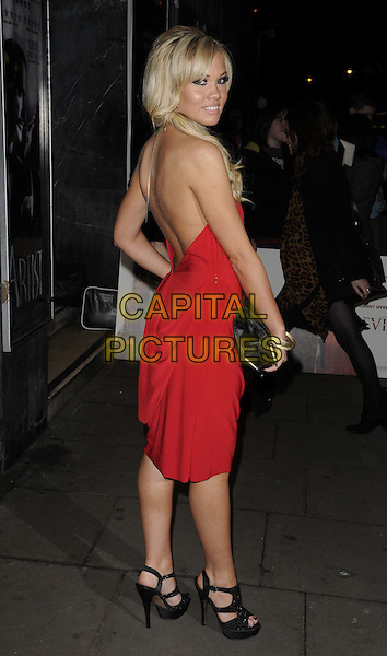 Sarah Beverley Jones .The 'Deviation' UK film premiere, Odeon Covent Garden cinema, Shaftesbury Avenue, London, England..February 23rd, 2012.full length red sleeveless dress backless looking over shoulder .CAP/CAN.©Can Nguyen/Capital Pictures.