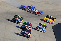 May 30, 2008; Dover, DE, USA; Nascar Craftsman Truck Series driver Scott Speed (22) leads a pack of trucks past a crashing Brendan Gaughan (10) during the AAA Insurance 200 at Dover International Speedway. Mandatory Credit: Mark J. Rebilas-US PRESSWIRE.