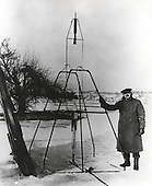 Doctor Robert H. Goddard and a liquid oxygen-gasoline rocket in the frame from which it was fired on March 16, 1926, at Auburn, Massachusetts. From 1930 to 1941, Doctor Goddard made substantial progress in the development of progressively larger rockets, which attained altitudes of 2400 meters, and refined his equipment for guidance and control, his techniques of welding, and his insulation, pumps and other associated equipment. In many respects, Doctor Goddard laid the essential foundations of practical rocket technology. He is considered one of the fathers of rocketry along with Konstantin Tsiolovsky (1857-1935) and Hermann Oberth (1894-1989).Credit: NASA via CNP