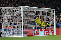 Olexandr Shovkovskiy of Dynamo Kyiv cannot prevent a free-kick by Willian of Chelsea (not shown) from making the score 2-1 during the UEFA Champions League Group match between Chelsea and Dynamo Kyiv at Stamford Bridge, London, England on 4 November 2015. Photo by David Horn.