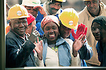 """JOHANNESBURG, SOUTH AFRICA AUGUST 10: Construction workers greet Oprah at the site of her school """"Oprah Winfrey Leadership Academy for Girls"""" located about 40 miles south of Johannesburg in Henley-on-Klip, Meyerton. Oprah visited South Africa to interview girls and to inspect the construction of the school. (Photo by Per-Anders Pettersson).."""
