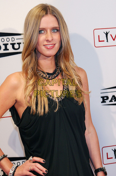 NICKY HILTON .Grand Re-Opening of the Hollywood Palladium operated by Live Nation which underwent a year-long makeover held at the Hollywood Palladium, Hollywood, California, USA, .15 October 2008..half length black top chain neckline .CAP/ADM/TC.©T Conrad/Admedia/Capital PIctures