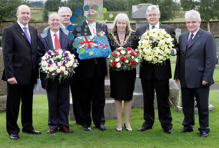 The laying of floral wreaths in the memory  of Sir George Fowlds at his headstone in the Fenwick Cemetery With Des Browne, Provost Stephanie Young, Willie Coffey MSP, Eric Milligan Hon Consul for New Zealand &amp; Robin Stewart..with some guests at the ceremony for the laying of the wreaths.<br /> The commemorative service marked the 75th anniversary of the death of the Hon George Fowlds, who was born in the village, but went on to be a leading figure in New Zealand political life<br /> Picture: 17 August 2009: Universal News and Sport (Scotland)<br /> All pictures must be credited to  www.universalnewsandsport.com.(0ffice) 0844 884 51 22.
