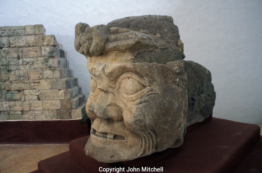 Maya Toothless Old Man of Copan or Pauahtun head from Temple 11, Copan Sculpture Museum, Copan, Honduras