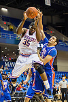 Texas-Arlington Mavericks forward Brandon Edwards (35) and Houston Baptist Huskies center Spenser Gales (33) in action during the game between the Houston Baptist Huskies and the Texas-Arlington Mavericks at the College Park Center arena in Arlington, Texas. UTA defeats Houston Baptist 81 to 47...
