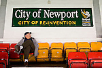 Newport County 1 Exeter City 1, 16/03/2014. Rodney Parade, League Two. Newport County finally return to the Football league after years of turmoil but a poor run of results has dented hopes of reaching the play-offs while Exeter City battle relegation. Newport County supporter and City of Newport sign. Photo by Simon Gill