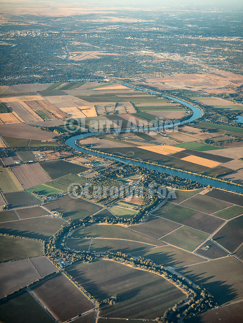 A bend in the Sacramento River from a window seat above south Sacramento County on final approach to Sacramento International Airport, Calif.