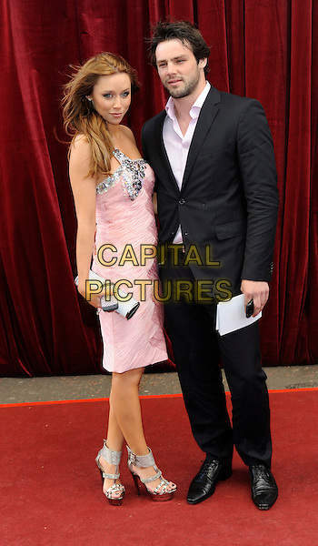 UNA HEALY - THE SATURDAYS & BEN FODEN.'An Audience with Michael Buble' Red Carpet arrivals at the London ITV Studios, South Bank, London, England..May 3rd 2010.full length pink dress silver clutch bag sandals one shoulder black suit couple platform.CAP/FIN.©Steve Finn/Capital Pictures.