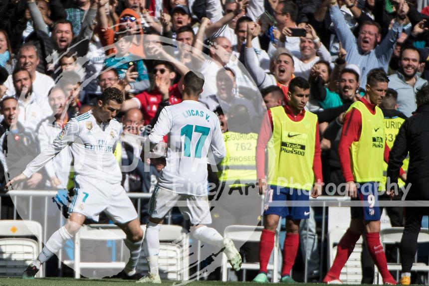 Real Madrid's Portuguese forward Cristiano Ronaldo celebrates after scoring<br /> Spanish league football match Real Madrid vs Atletico de Madrid at the Santiago Bernabeu stadium in Madrid on April 8, 2018.