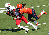 Virginia cornerback Demetrious Nicholson (1) Ball State wide receiver Jordan Williams (8) Ball State defeated Virginia 48-27 during an NCAA football game Saturday Oct. 5, 2013 at Scott Stadium in Charlottesville, VA. Photo/Andrew Shurtleff
