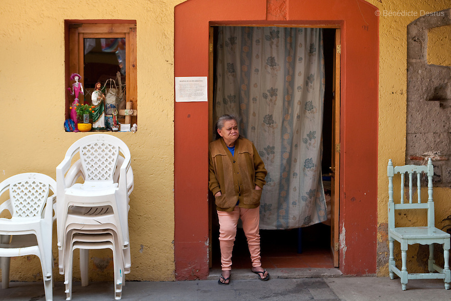 Canela, resident of Casa Xochiquetzal, stands in front of her bedroom at the shelter in Mexico City, Mexico on October 4, 2010. Casa Xochiquetzal is a shelter for elderly sex workers in Mexico City. It gives the women refuge, food, health services, a space to learn about their human rights and courses to help them rediscover their self-confidence and deal with traumatic aspects of their lives. Casa Xochiquetzal provides a space to age with dignity for a group of vulnerable women who are often invisible to society at large. It is the only such shelter existing in Latin America. Photo by Bénédicte Desrus