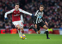 GranitXhaka of Arsenal and Isaac Hayden of Newcastle United during the Premier League match between Arsenal and Newcastle United at the Emirates Stadium, London, England on 16 December 2017. Photo by Vince  Mignott / PRiME Media Images.