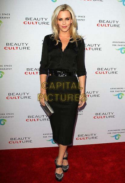 JENNY McCARTHY .at The opening of Beauty Culture - a photographic exploration of how feminine beauty is defined, challenged and revered in modern society held at Annenberg Space for Photography in Century City, California, USA,.May 19th 11..full length black shirt  pencil skirt clutch bag shoes  silver  belt .CAP/ADM/KB.©Kevan Brooks/AdMedia/Capital Pictures.