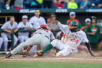 Miami Hurricanes outfielder Jacob Heyward (24) slides hime during the NCAA College baseball World Series against the Arkansas Razorbacks  on June 15, 2015 at TD Ameritrade Park in Omaha, Nebraska. Miami beat Arkansas 4-3. (Andrew Woolley/Four Seam Images)