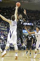 SEATTLE, WA - DECEMBER 11:  Nevada's Cameron Oliver against Washington.  Nevada defeated Washington 87-85 at Alaska Airlines Arena in Seattle, WA.