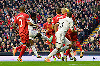 Sunday, 23 February 2014<br /> Pictured: Swansea City's Wilfried Bony scores the second goal. 2-2<br /> Re: Barclay's Premier League, Liverpool FC v Swansea City FC v at Anfield Stadium, Liverpool Merseyside, UK.