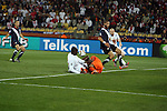 12 JUN 2010:  Emile Heskey (ENG)(center/left) shoots on goal as Tim Howard (USA)(center/right) blocks the shot as Wayne Rooney (ENG)(right), Oguchi Onyewu (USA)(right), and Steve Cherundolo (USA)(6) follow the play.  The England National Team and the United States National Team were tied 1-1 after the first half at Royal Bafokeng Stadium in Rustenburg, South Africa in a 2010 FIFA World Cup Group C match.