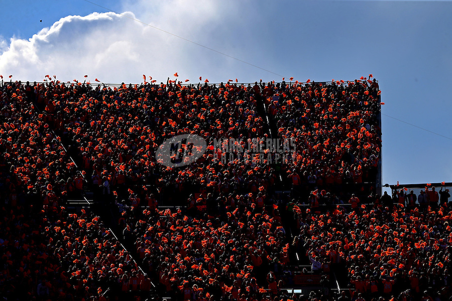 Jan 24, 2016; Denver, CO, USA; Denver Broncos fans wave orange pom poms in the crowd against the New England Patriots in the AFC Championship football game at Sports Authority Field at Mile High. The Broncos defeated the Patriots 20-18 to advance to the Super Bowl. Mandatory Credit: Mark J. Rebilas-USA TODAY Sports