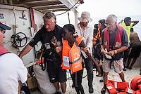 Sea Watch-2.<br /> Die Sea Watch-2 bei ihrer 13. SAR-Mission vor der libyschen Kueste.<br /> Im Bild: Gefluechtete werden an Bord der Sea Watch-2 aufgenommen. Der Missionsleiter Ingo Werth (links) kuemmert sich um eine gefluechtete Mutter.<br /> 21.10.2016, Mediterranean Sea<br /> Copyright: Christian-Ditsch.de<br /> [Inhaltsveraendernde Manipulation des Fotos nur nach ausdruecklicher Genehmigung des Fotografen. Vereinbarungen ueber Abtretung von Persoenlichkeitsrechten/Model Release der abgebildeten Person/Personen liegen nicht vor. NO MODEL RELEASE! Nur fuer Redaktionelle Zwecke. Don't publish without copyright Christian-Ditsch.de, Veroeffentlichung nur mit Fotografennennung, sowie gegen Honorar, MwSt. und Beleg. Konto: I N G - D i B a, IBAN DE58500105175400192269, BIC INGDDEFFXXX, Kontakt: post@christian-ditsch.de<br /> Bei der Bearbeitung der Dateiinformationen darf die Urheberkennzeichnung in den EXIF- und  IPTC-Daten nicht entfernt werden, diese sind in digitalen Medien nach §95c UrhG rechtlich geschuetzt. Der Urhebervermerk wird gemaess §13 UrhG verlangt.]