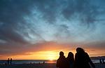 People watching the sunset aty Santa Monica beach.