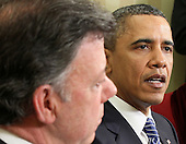 United States President Barack Obama (R) speaks as President Juan Manuel Santos of Columbia listens during their meeting April 7, 2011 in the Oval Office of the White House in Washington, DC. Both presidents were expected to approve the recently agreed-upon Action Plan Related to Labor Rights and to discuss next steps with regard to the U.S.-Colombia Trade Promotion Agreement, according the a White House news release. .Credit: Alex Wong / Pool via CNP